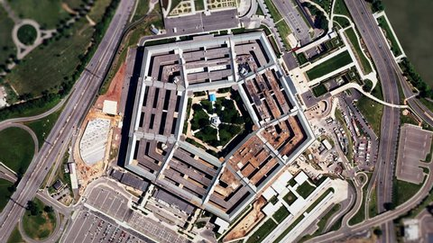 Satellite Zoom into U.S. Pentagon (30fps). A slow aerial zoom in on the United States Pentagon building in Arlington, Virginia, shot from a satellite perspective above with moving clouds and traffic.