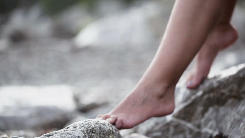 Bare legs on pebble beach #6953353