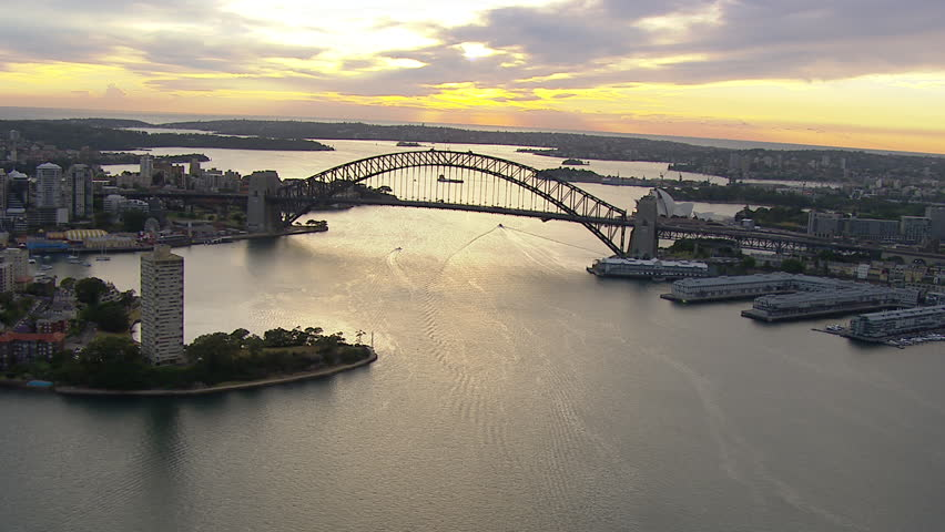 Wide aerial shot of the Sydney Harbour Bridge from west to east / south WITH Circular Quay, Botanic Gardens, CBD,  Milson's Point, Luna Park, Walsh Bay, Farm Cove & Potts Point #6975742