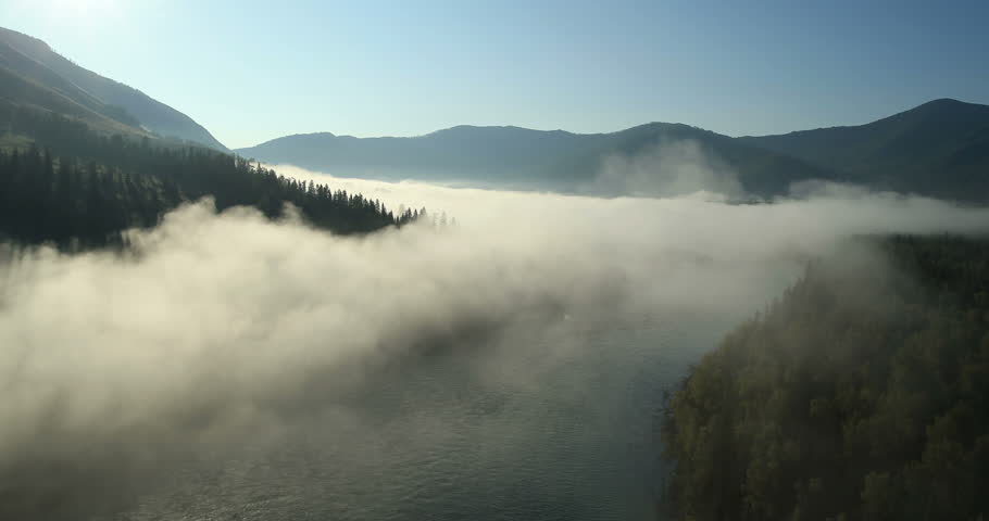 Aerial View: Flight over the Mountains. Altai. Siberia. Flying over the River. Forest Valley. Morning Fog. 4K resolution. | Shutterstock HD Video #6993523