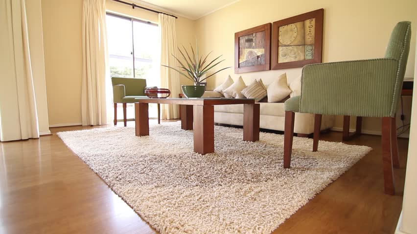 SANTIAGO, CHILE - A living room with two white sofas with grey cushions are  back