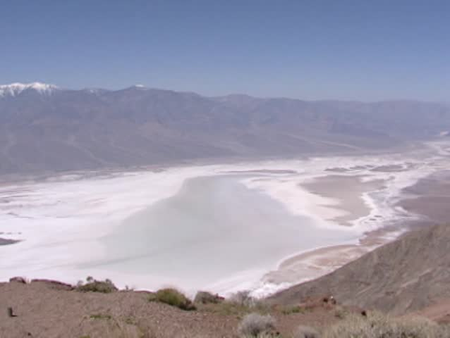Death Valley, Dantes view: Badwater, salt deposits, Panamint Range and the surrounding desert - pan across the lowest point in the Western Hemisphere and one of the hottest places in the world.