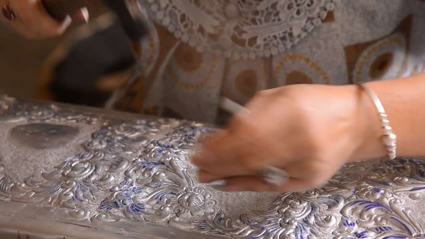 Silver art handicrafts of Lanna, Thai style, Chiang Mai, Thailand, hand banging on silver with a hammer.
