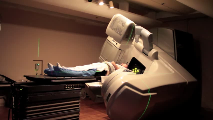 CIRCA 2010s - A patient is given radiation imaging treatment for a cancer diagnosis.
