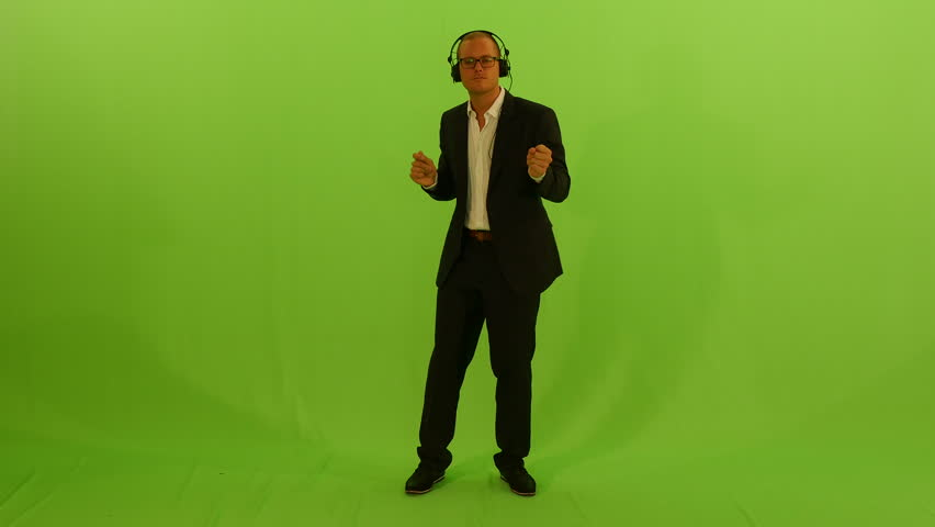 Dancing businessman isolated on green screen … - Royalty