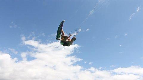 Man Kitesurfing In Ocean In Summer Does Extreme Trick