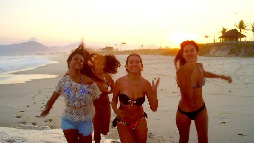 Young Beautiful Women Hily Run Down A Beach
