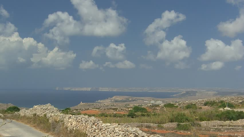 Time lapse coastline of Malta Island with cloudscape