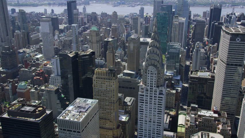 Aerial view of the Chrysler building in New York City. Famous iconic skyscraper towers over NYC. Helicopter shot circling the landmark building. | Shutterstock HD Video #7245583