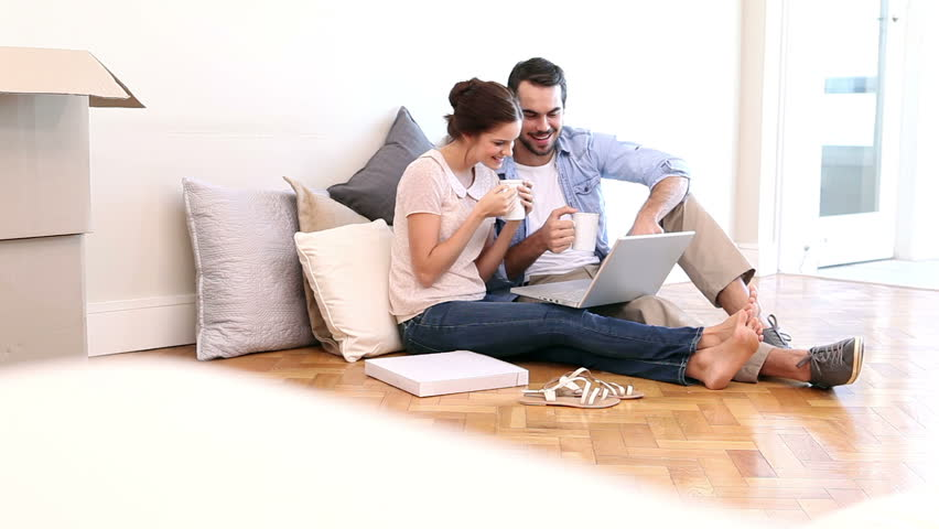 Attractive Couple Using Laptop On The Floor In Their New Home   HD Stock  Video Clip