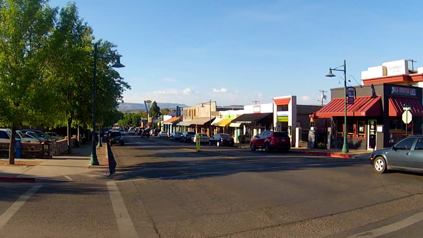 COTTONWOOD, AZ: August 1, 2014- Wide shot of traffic in the historic downtown circa 2014 in Cottonwood, Arizona. Commuting in a small town is easy with very light traffic patterns.