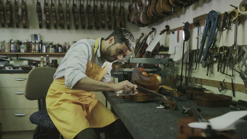 Craftsman in his workshop, making and restoring violins | Shutterstock HD Video #7315663