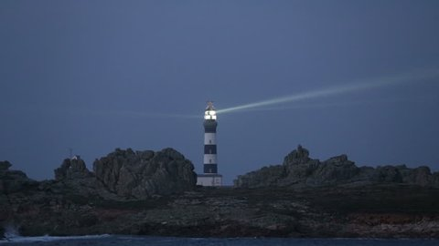 Creach lighthouse illuminated in evening, the most powerful in the world, Ushant island (aka Ouessant), Brittany, France