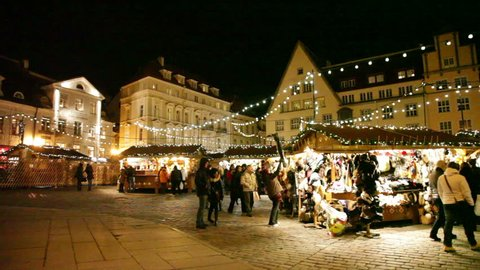 TALLINN, ESTONIA - DECEMBER 31, 2013: People on a central square of the city on New Year's Eve. Tallinn - the largest city and the capital of Estonia. Large passenger and cargo seaport.