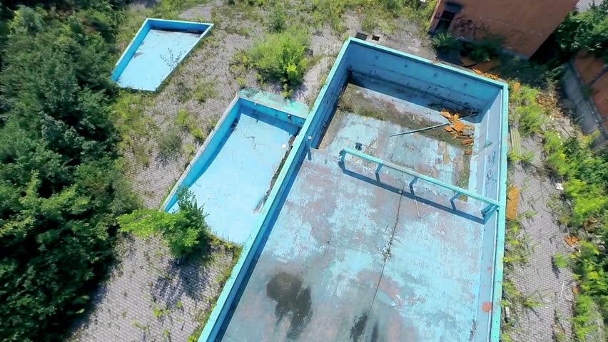 LJUBLJANA, SLOVENIA   AUGUST 2014: High Aerial Shot Of Abandoned Pool. Old  Unused