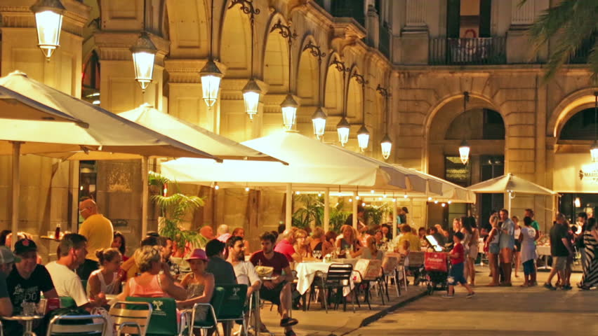 BARCELONA, SPAIN - JULY 18, 2014: Night view of Placa Reial with restaurants in summer. Barcelona, Catalonia