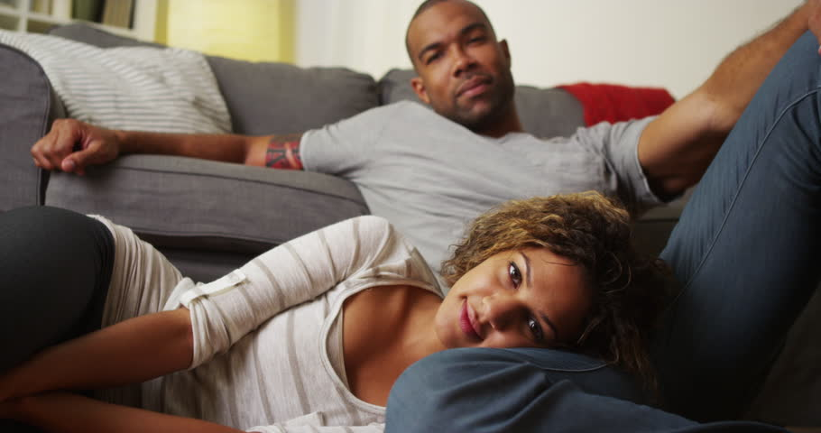 African American couple smiling and looking at camera | Shutterstock HD Video #7400518