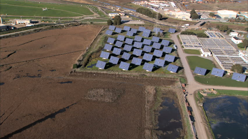 Aerial view of solar energy panels & production plant on industrial land