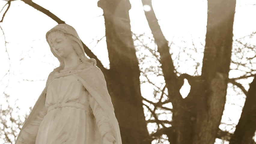 virgin mary statue at cemetery, dolly shot - 720p