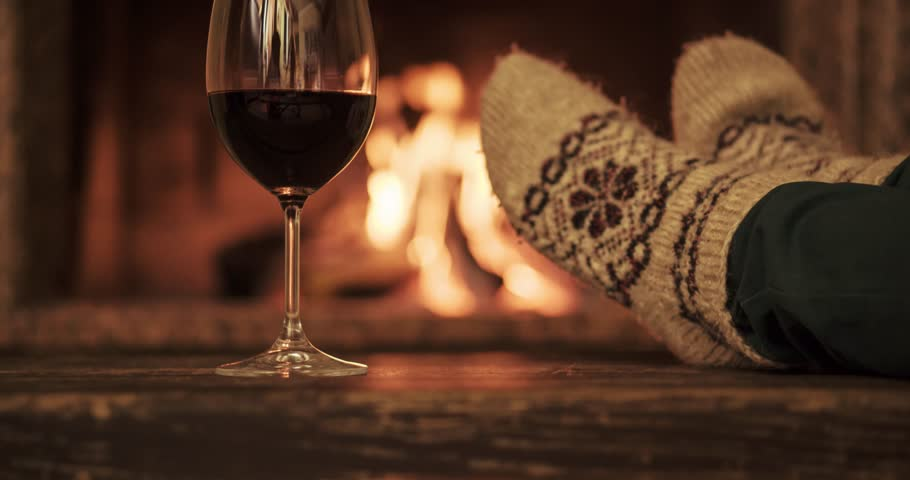 Cozy By The Fireplace Couple Toasting With Red Winethe Cozy Fireplaceclose Up