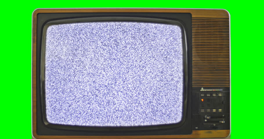 1970s TV set with green screen background. 76 years of television history came to an end at midnight on Wednesday 24 October 2012 when the analogue TV signal was switched off. (UK, July 2014)  | Shutterstock HD Video #7434733