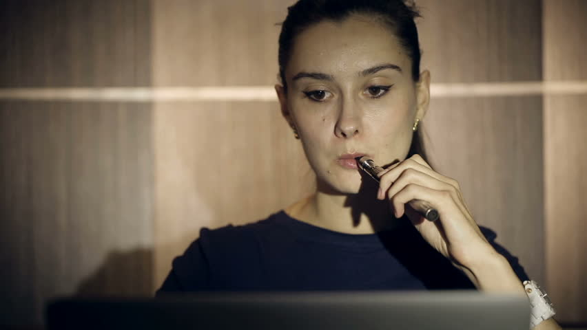 Business woman smoking an electronic cigarette indoors. Close up | Shutterstock HD Video #7436503