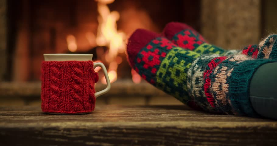 Woman Relaxes By Warm Fire And Wriggles Her Toes. Cozy Evening By ...