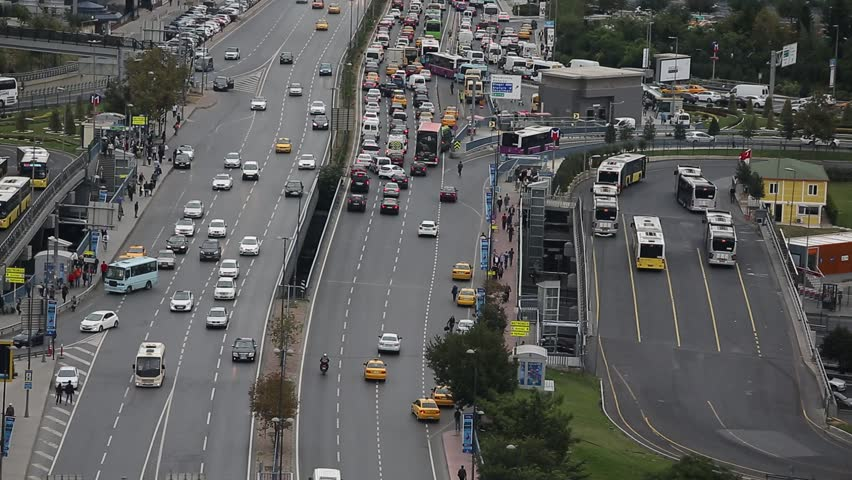 ISTANBUL, TURKEY - SEPTEMBER 26: Slow moving traffic makes its way across a major highway in Istanbul on September 26, 2014 in Istanbul, Turkey | Shutterstock HD Video #7453543