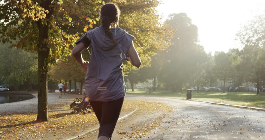 Runner woman running in park exercising outdoors fitness tracker wearable technology | Shutterstock Video #7457047