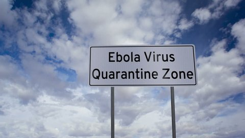 Highway road sign with the words Ebola Virus Quarantine Zone written on it with a time-lapse clouds background.