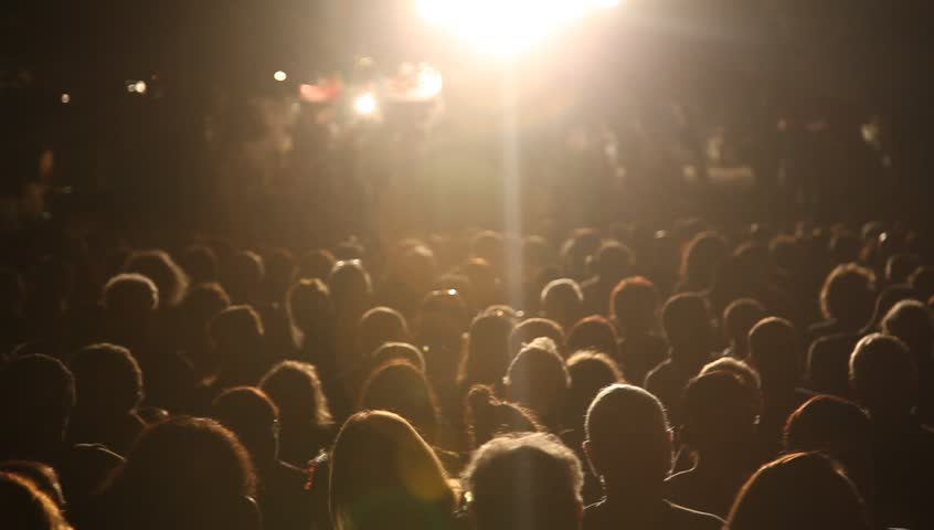 Anonymous crowd during a concert during a break | Shutterstock HD Video #7559113