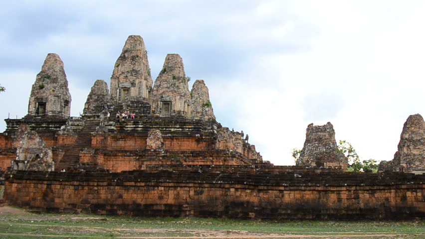 Zoom Out - Stone Wall with Temple Remains in the Background - Angkor Wat Temple Cambodia #7566313