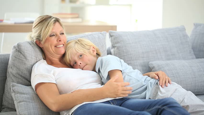 Stock Video Clip Of Mother And Little Boy Relaxing In Sofa -8266