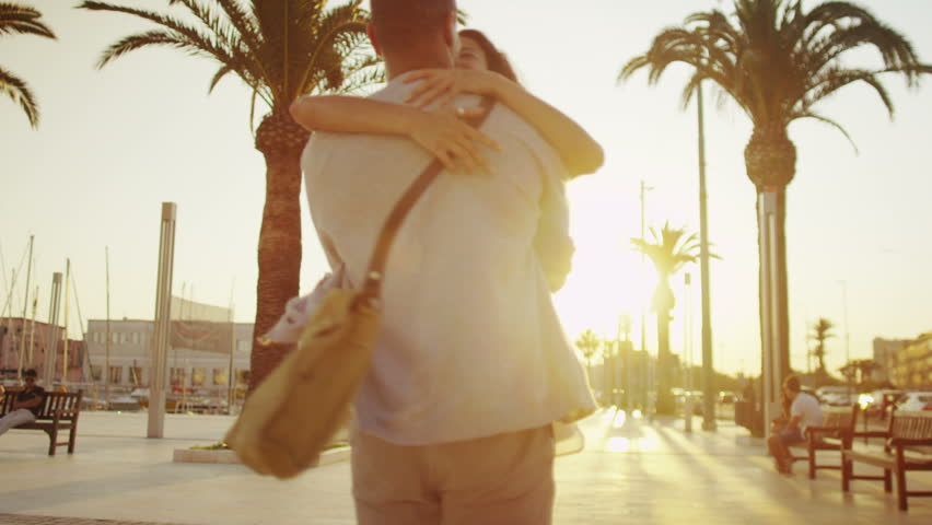 Happy romantic couple on vacation, outdoors in Italian city as sun begins to set | Shutterstock HD Video #7619143