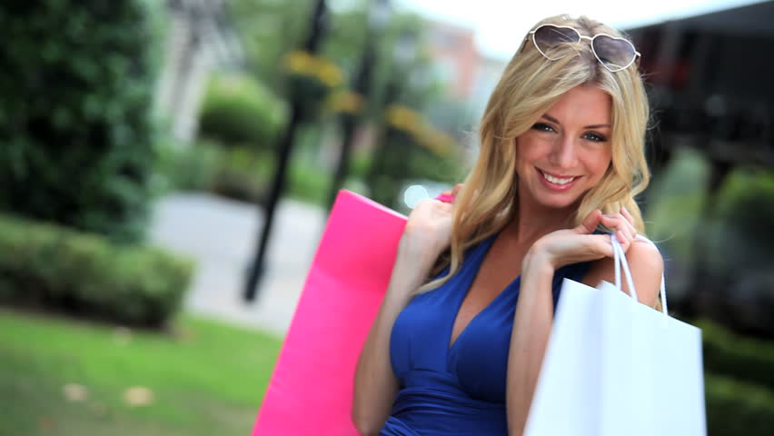 Beautiful young blonde girl enjoying her shopping lifestyle