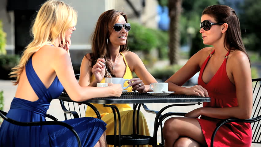 Three sophisticated female friends celebrating at outdoor cafe after a successful shopping trip | Shutterstock HD Video #763723