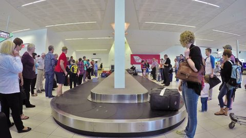 Adelaide, Australia - Oct 16: 4k timelapse video of traveller at the baggage claim of the Adelaide Airport on Oct 16, 2014. Adelaide Airport is the principal airport of Adelaide, South Australia.