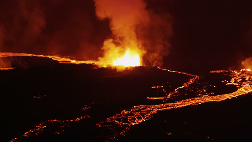 Aerial night volcanic lava Holuhraun eruption magma emerging land fissures seismic activity cloud formation Iceland Europe RED EPIC