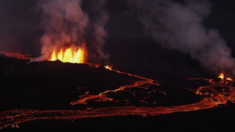 Aerial darkness lava rivers nature molten fire eruption Holuhraun volcano geology seismic pollution force Bardarbunga Iceland RED EPIC