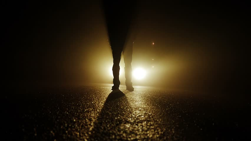 silhouette of person walking into dark night. car lights beaming background - HD stock video : mystical lighting - azcodes.com
