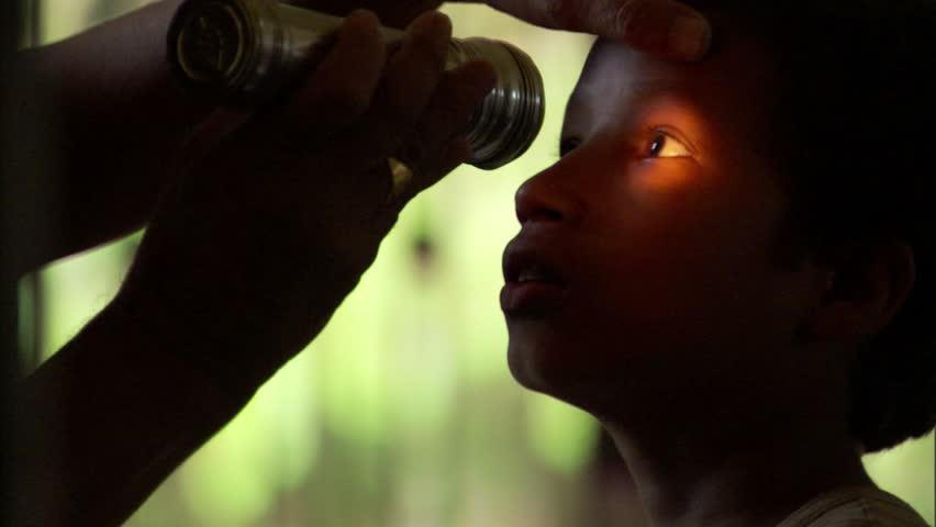 Nepalese child receiving an eye exam, | Shutterstock HD Video #7810123