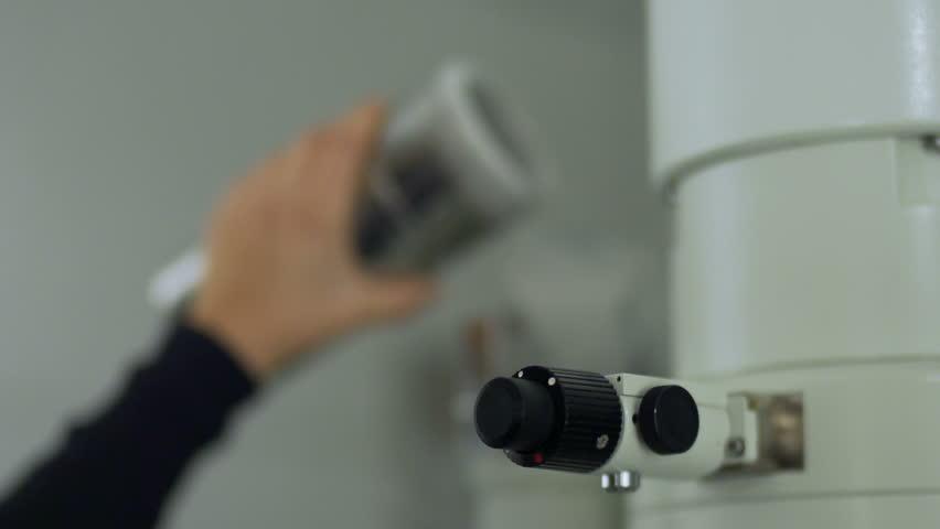 Electron microscope - pouring liquid nitrogen | Shutterstock HD Video #7818643
