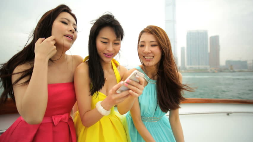 American Asian Chinese three attractive successful girlfriends tourism travel Hong Kong harbor cityscape outdoors wireless smart phone | Shutterstock HD Video #7849693
