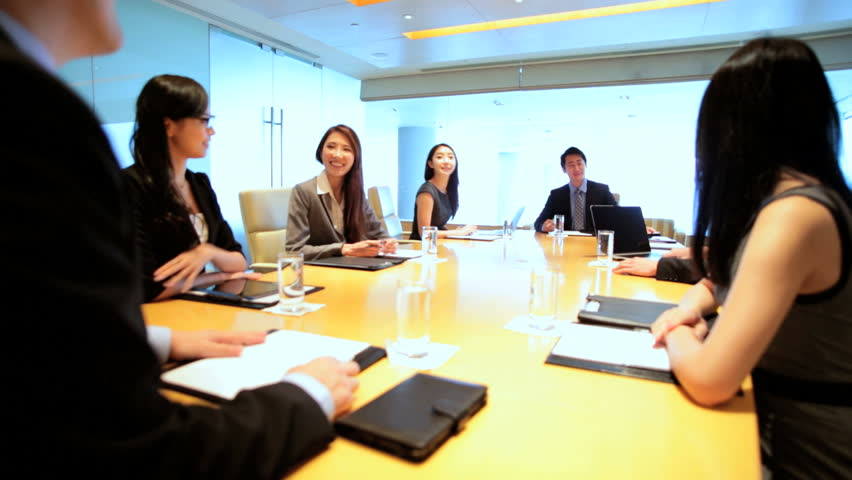 Young team ambitious male female Asian Chinese financial business global communication wireless technology boardroom meeting | Shutterstock HD Video #7852123