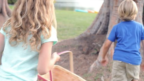 Two children searching for easter eggs in garden together. Shot on Canon 5D MkII at frame rate of 25fps