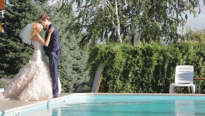 Bride Pushing Groom In The Swimming Pool Stock Footage Video ...