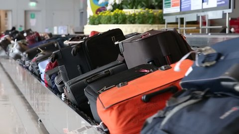 BANGKOK, THAILAND - NOVEMBER 14, 2014: Baggage conveyor belt in the Suvarnabhumi Airport carrying the passenger luggage.