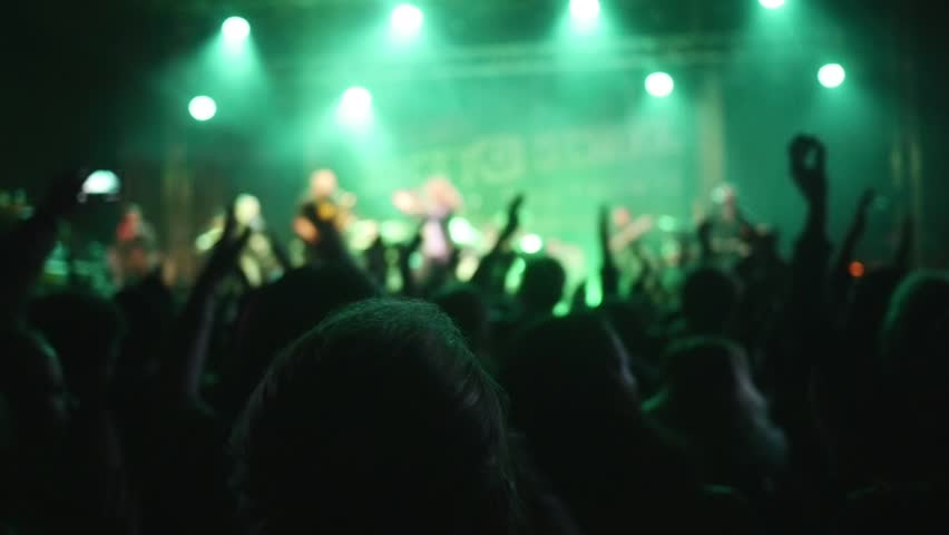 People dancing at open air rock festival