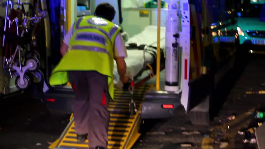 BRISTOL - July 6: Medic Pulling Stretcher Out of Ambulance at St Pauls Carnival - July 6 2013 in Bristol England