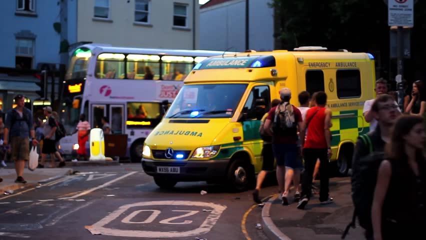 BRISTOL - July 6: Ambulance Driving Through Crowd at St Pauls Carnival - July 6 2013 in Bristol England
